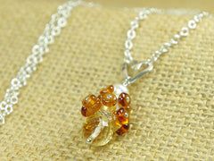 Diana necklace. Hessonite garnets, with a white freshwater cultured pearl and citrine. Suspended from a polished sterling silver handmade heart on a sterling silver chain. Sweet Heart Collection. 46cm chain.  Jewellery by Linda