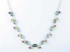 Elegance necklace. Rutile quartz, yellow sapphire, red spinel, silver.