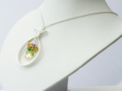 Eva necklace. Handmade polished sterling silver 'apple' shape with citrine, peridot, Madeira citrine, amethyst and Russian diopside suspended within it . Harmony Collection. 46cm chain. 5cm long pendant