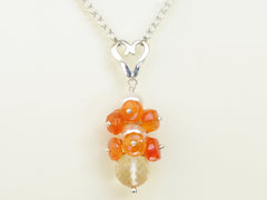 Lalita necklace. Carnelians with a white freshwater cultured pearl and citrine. Suspended from a polished sterling silver handmade heart on a sterling silver chain. Sweet Heart Collection. 46cm chain. 3.5cm pendant