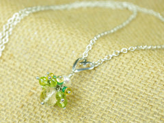 Persephone necklace. Emeralds, yellow sapphires and peridots with a white freshwater cultured pearl and citrine. Suspended from a polished sterling silver handmade heart on a sterling silver chain. One of a kind. 46cm chain. 3cm pendant
