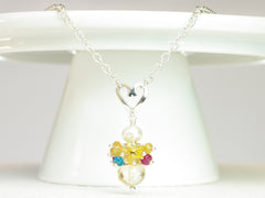 Rebecca necklace. Longido rubies, yellow sapphires and apatites with a white freshwater cultured pearl and citrine. Suspended from a polished sterling silver handmade heart on a sterling silver chain. Sweet Heart Collection. 46cm chain. 3cm pendant