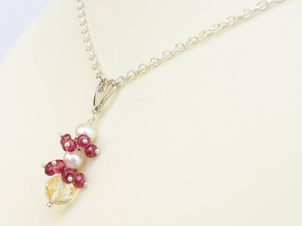 Roslyn necklace. Red spinel with a white freshwater cultured pearl and citrine. Suspended from a polished sterling silver handmade heart on a sterling silver chain. Sweet Heart Collection. 46cm chain. 3.5cm pendant