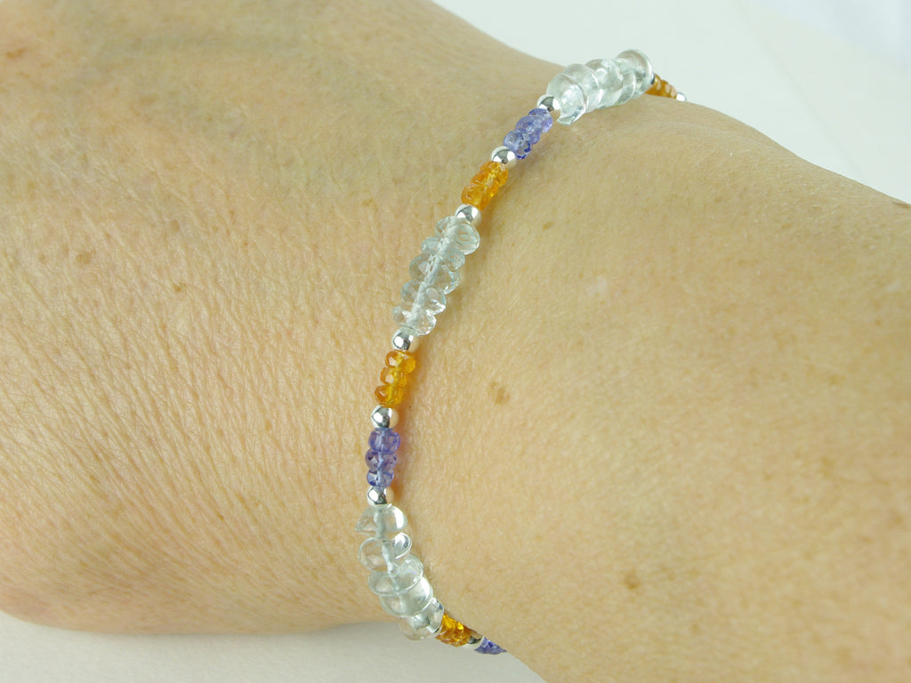 Sweet Dreams Bracelet - Aquamarine, Tanzanite, Mandarin Garnet close up on the hand