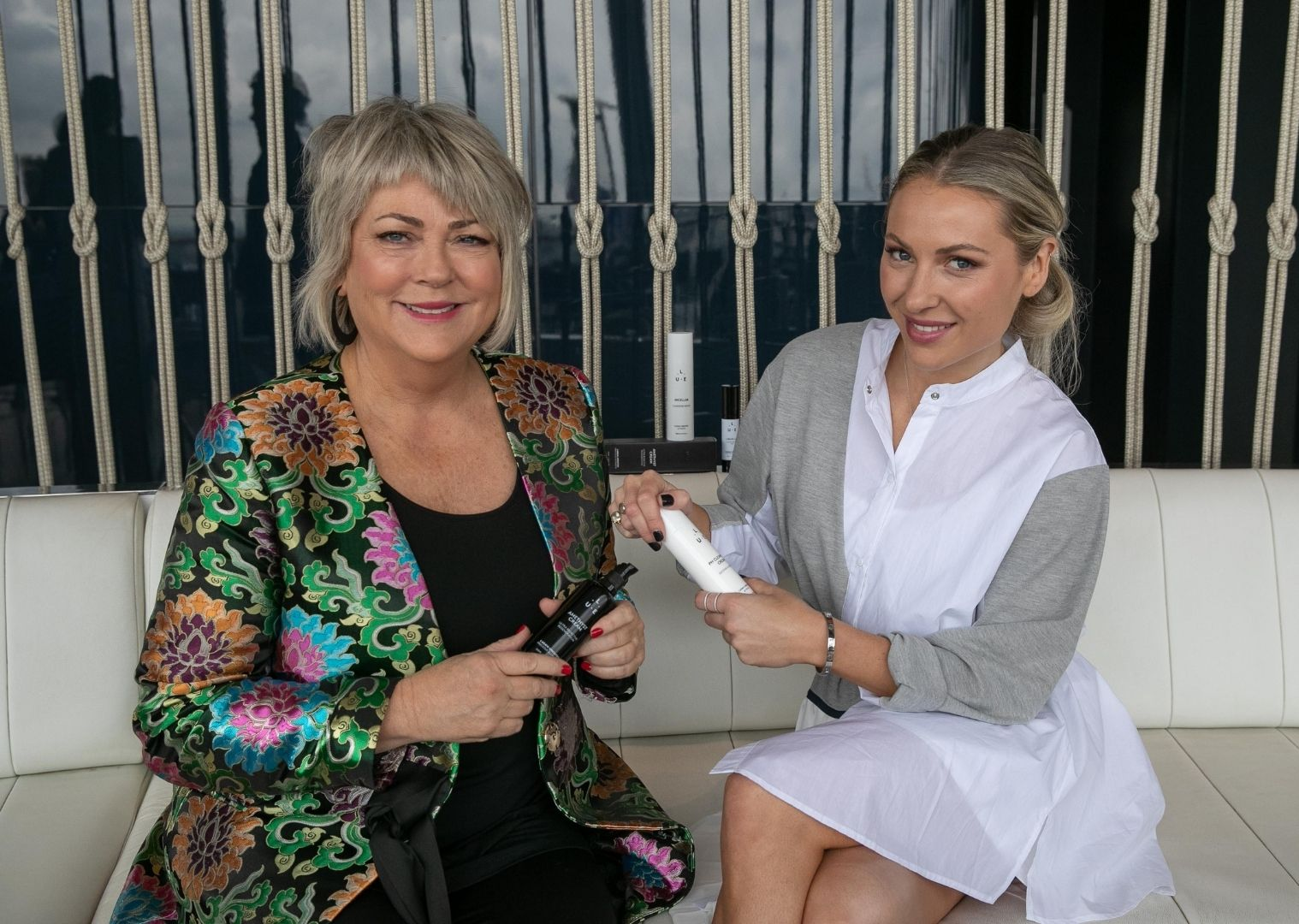 Jean and Kristen of LaGaia UNEDITED holding their beauty products