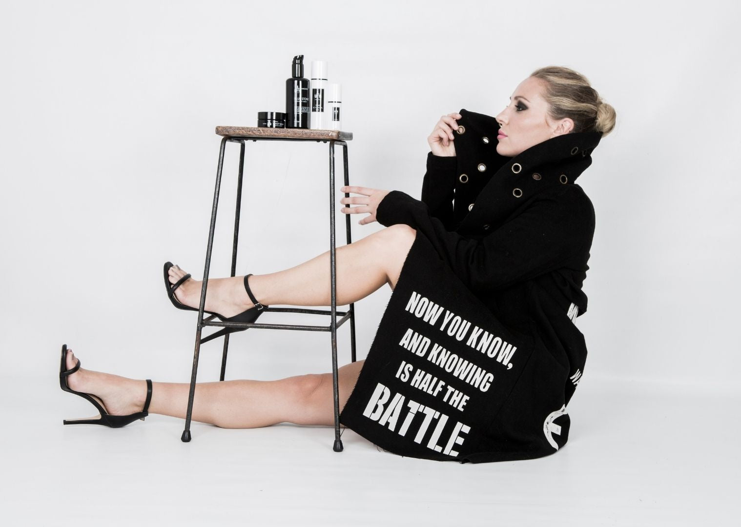 Kristen beauty photoshoot with a jacket that reads now you know