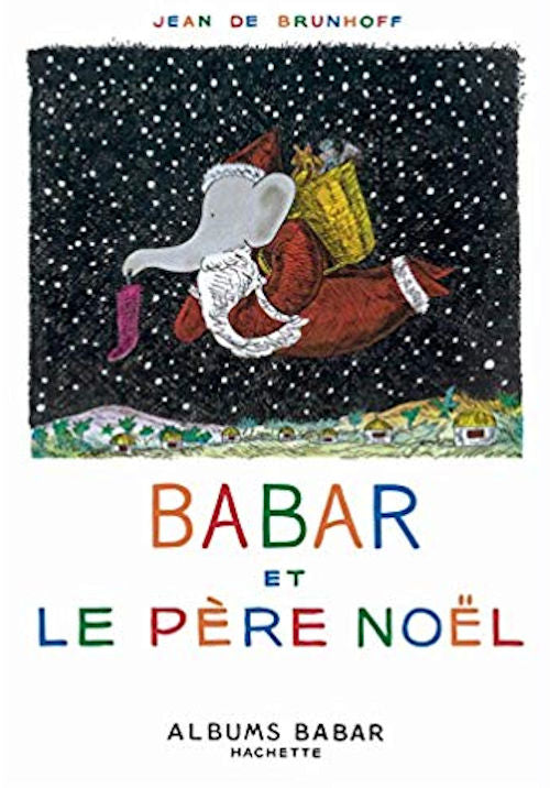 Babar et le Père Noël by Jean de Brunhoff. That classic elephant and Santa Claus in French.