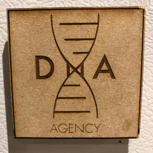 Custom brand magnets laser-cut with corporate logo for DNA Agency.