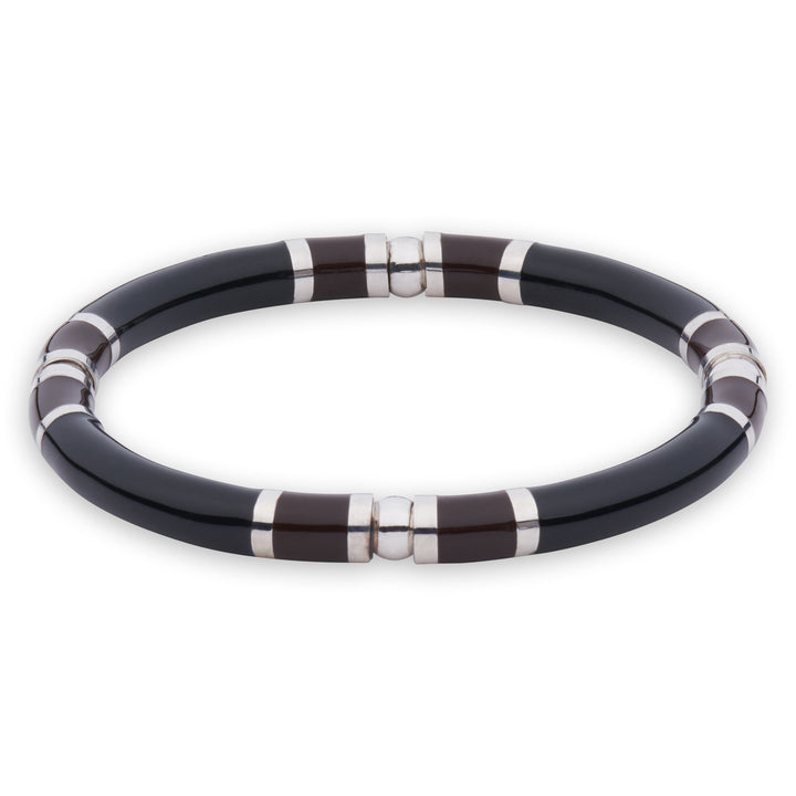 Xtinctio - Stretch Bangle comfortable, timeless and chic. Hand made in Italy by a 3rd generation Goldsmith with eco conscious white bronze and enamel.  Imbued with the spirit of the endangered Rhinoceros