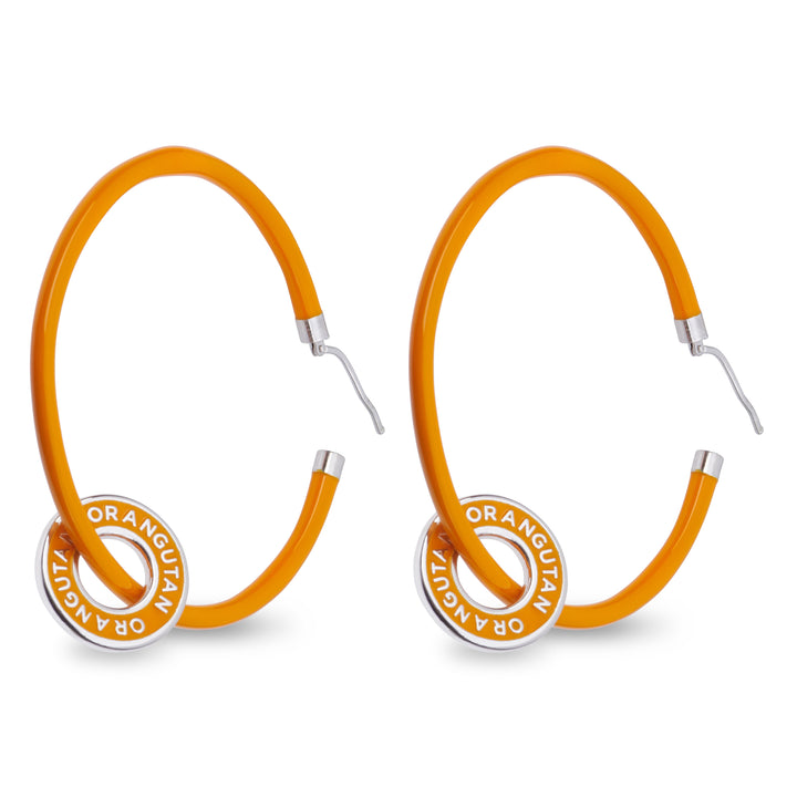 "Xtinctio - These eco conscious orange Hoop Earrings and attached circle pendant engraved with the word ""Orangutan"" are hand made"