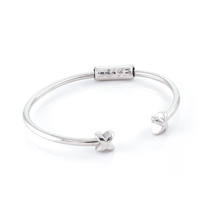 Xtinctio - Bracelet/Bangle made in Italy Recycled Sterling silver Love XX bracelet eco conscious, chic and comfortable representing your commitment to protecting these critically endangered species and their habitats. An  X  at each end of the bangle and bead with the  word Love debossed  on it.