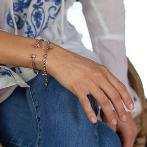 Sterling silver charm bracelet representing your commitment to protecting these critically endangered species and their habitats.  Price includes 5 animal charms.