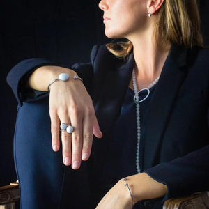 Xtinctio - This Etruscan Sphere Ring is hand made in Italy by a 3rd generation goldsmith using 925 Silver and enamel.  Engraved with our X logo, it is a positive reminder of our connection to every living thing in this age of extinction.  Our partner in Ocean