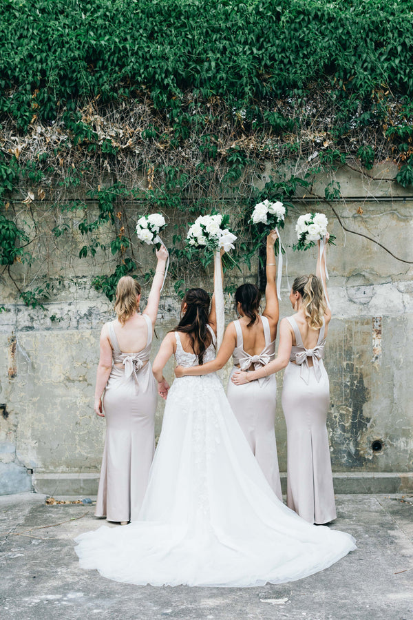 bride and bridesmaids in their dresses with bouquets