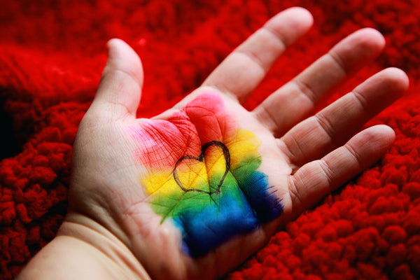 hand-with-pride-flag-and-love-heart-painted-in-palm