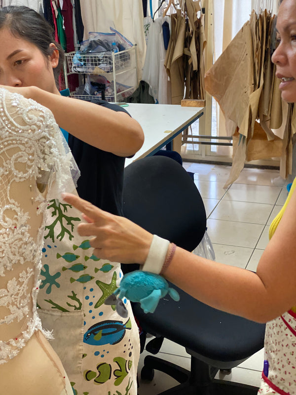 seamstresses hand sewing a custom made wedding dress at Brisbane bridal studio