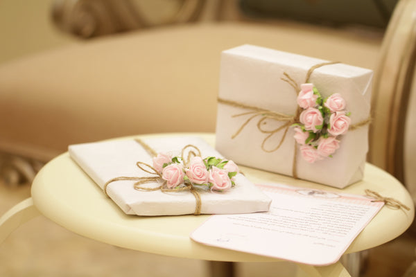 wedding gifts on table with registry list