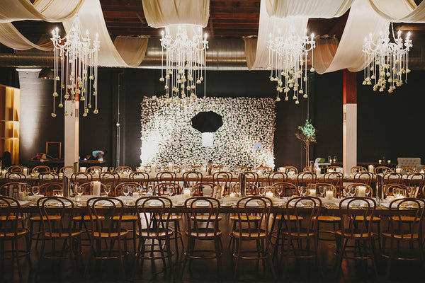 wedding reception venue with seating arrangements tables and chandeliers