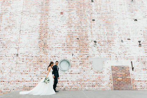Bride with groom walking outside Brisbane Powerhouse