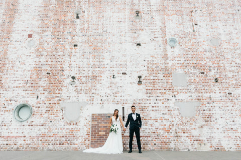 Bride and groom at Brisbane powerhouse posing for portraits