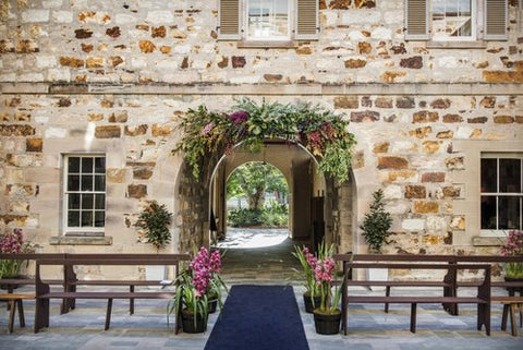 Brick walls and seating with flower arches at Old Government House in Brisbane
