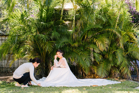 bridal designer and bride in wedding dress in garden