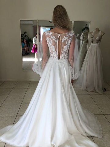 bride fitting wedding dress made from white satin lace and tulle in Brisbane bridal studio