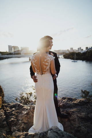 bride in wedding dress with groom at Kangaroo Point Cliffs in Brisbane