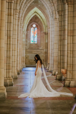bride in church on wedding day in her wedding gown