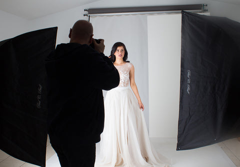 bride in wedding dress with photographer at Brisbane studio
