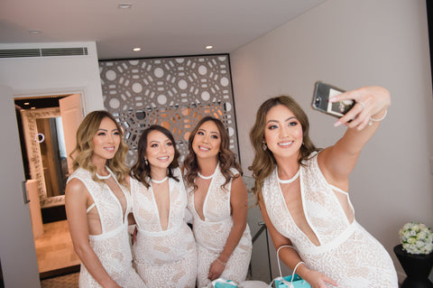 bridesmaids on wedding day taking a selfie