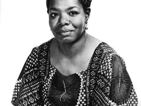 portrait of writer Maya Angelou wearing dress and earrings