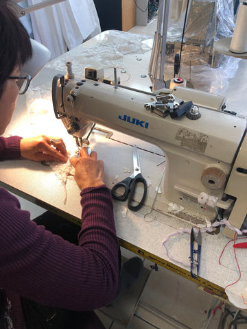 seamstress hand makes custom made gown