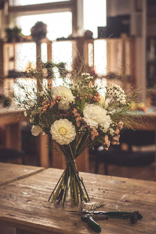 wedding day bouquet on table with flower cutters