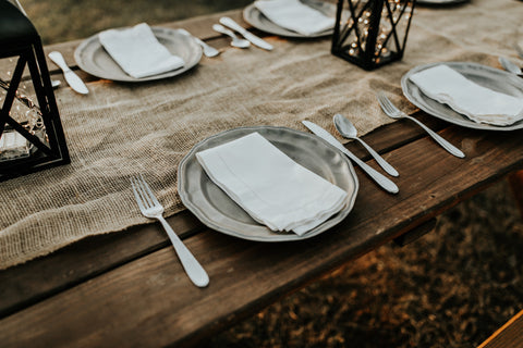 wedding table settings with plates and cutlery