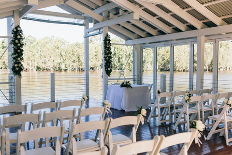wedding venue on lake with white seating arrangements