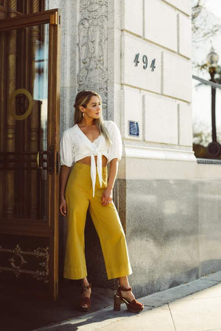White tie front crop top outfit with mustard wide leg cropped pants