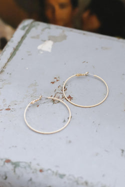 thin gold shimmer hoop earrings