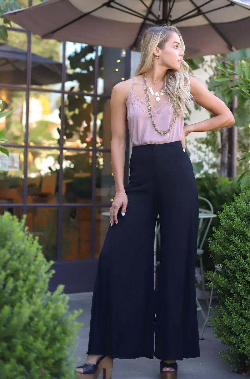 Black high waisted zippered pants with wide leg