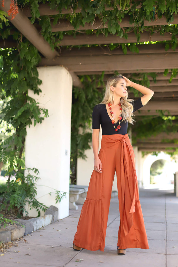 rust colored high waisted flowy pants