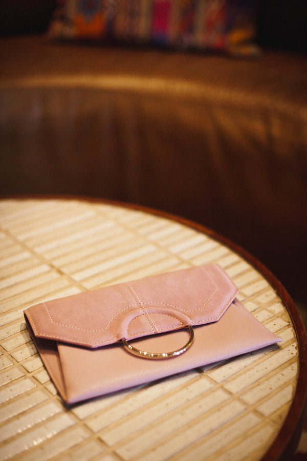 Pale pink leather clutch