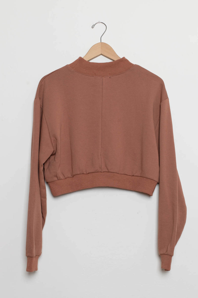 terracotta colored sweater