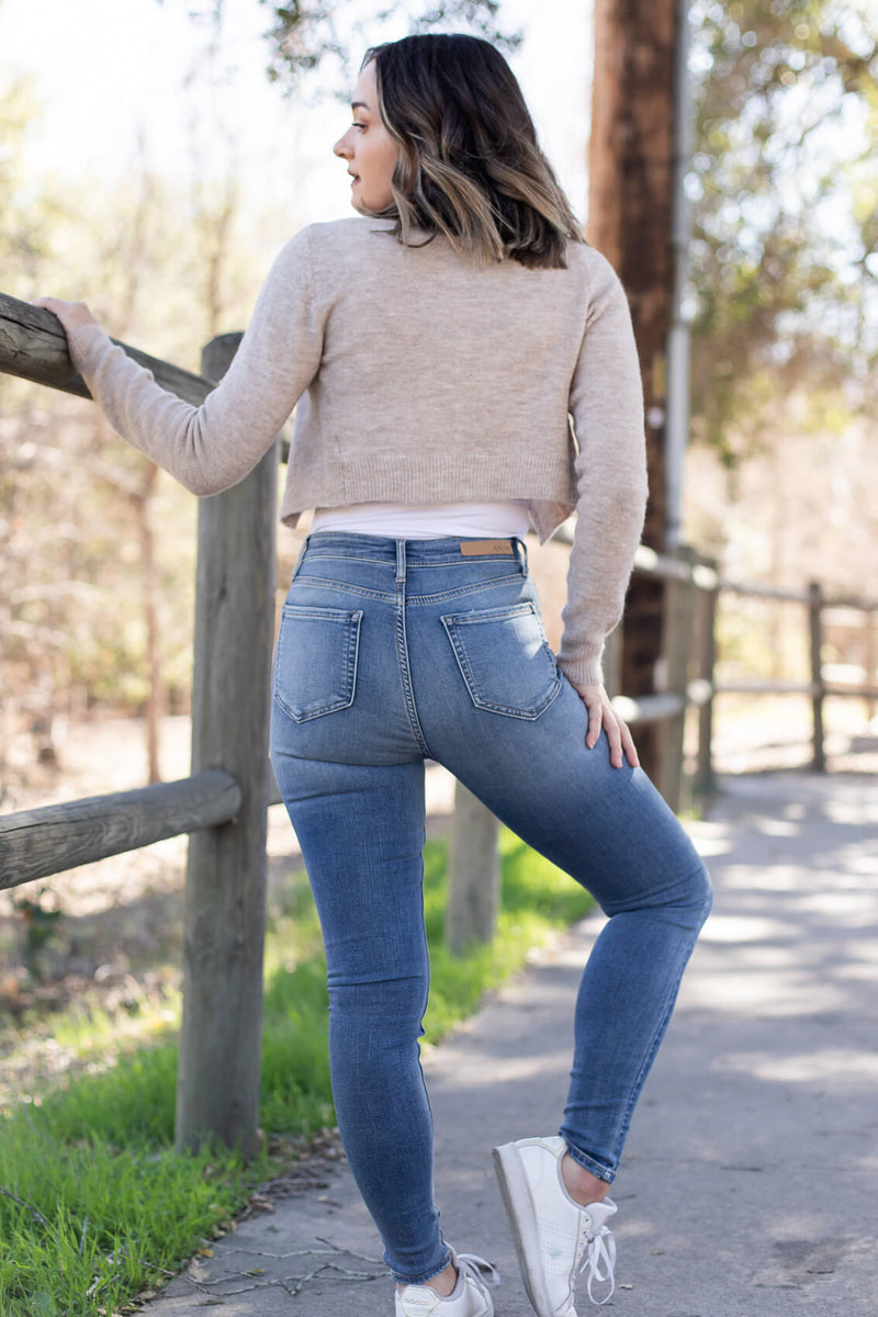 high waisted mid wash skinny jeans