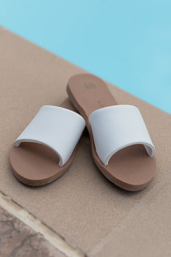 white slip on sandals