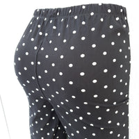 Black leggings with white polka dots
