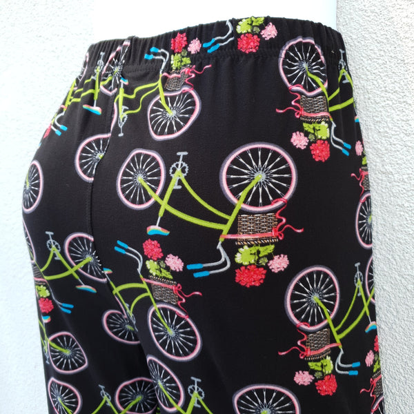 Black leggings with a cute print of a bicycle with flowers in the basket