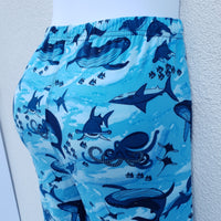 Blue leggings with a deep sea design