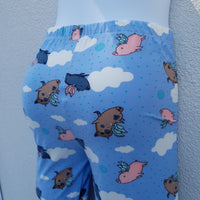 Flying Pig graphic on sky blue leggings