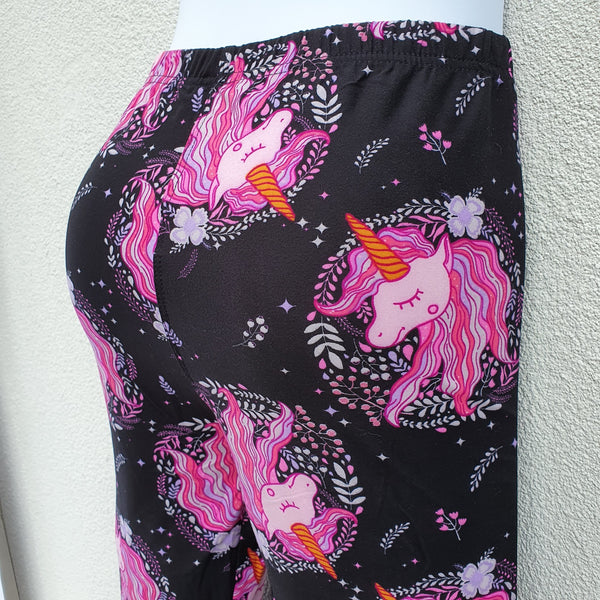 Black leggings with pink unicorn graphic