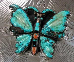 Leekya Deyuse carved turquoise butterfly closeup